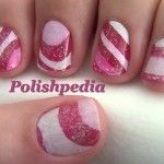 Candy Cane Nail Art!  Yummy enough to eat!    Watch The Tutorial @ http://www.polishpedia.com/candy-cane-nail-art.html