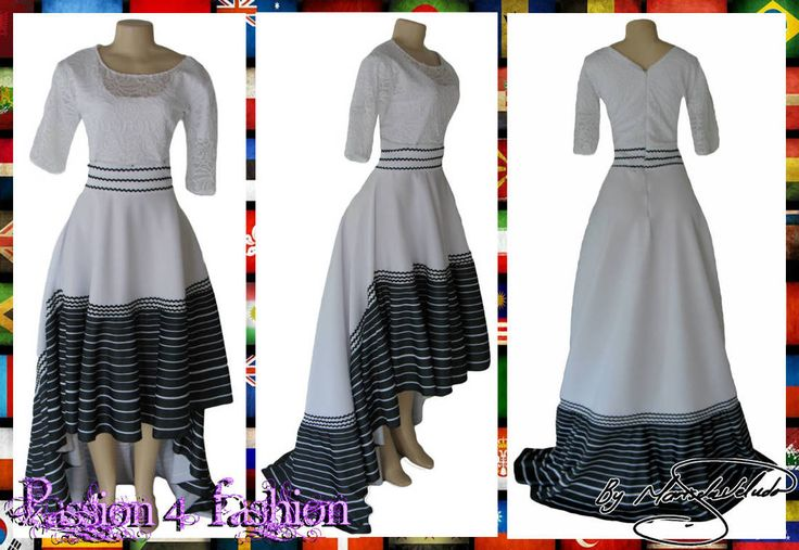 Xhosa black and white hi low traditional dress with a lace bodice and short sleeves.