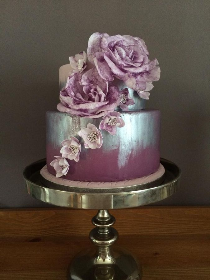 I am loving the color of the cakes and mix of colors but the splatter flower colors brings it don to me! Made by elivrah4 Purple, silver cake and wafer paper flowers