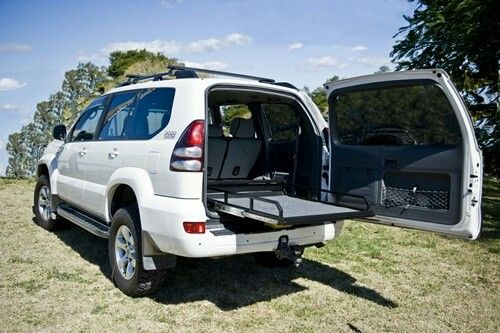 The Landcruiser prado 120 cargo tray is easily removed if the extra seats are needed.