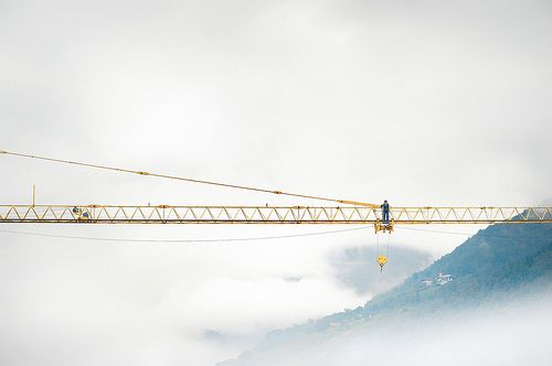 Yellow crane in the clouds