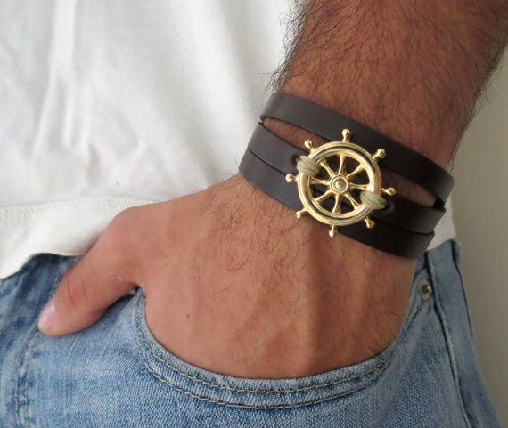 """Men's Bracelet - Black Leather Bracelet With Gold Plated Steering Wheel Pendant - Mens Jewelry - Mens Cool Jewelry - Gift for Him  Looking for a gift for your man? You've found the perfect item for this!   The simple and beautiful bracelet combines black leather which wrap 3 times on hand and a gold plated steering wheel pendant with a khaki-colored wire wrapped on it.  Lengh: 22.8 (53 cm) + 2"""" (5 cm) extension chain.  $37"""