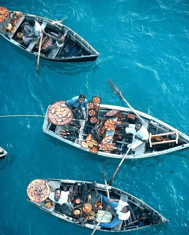 BUM BOATS OF #HAITI - Port-au-Prince, selling wooden carvings to guests of cruise ships, by Bulent Atalay