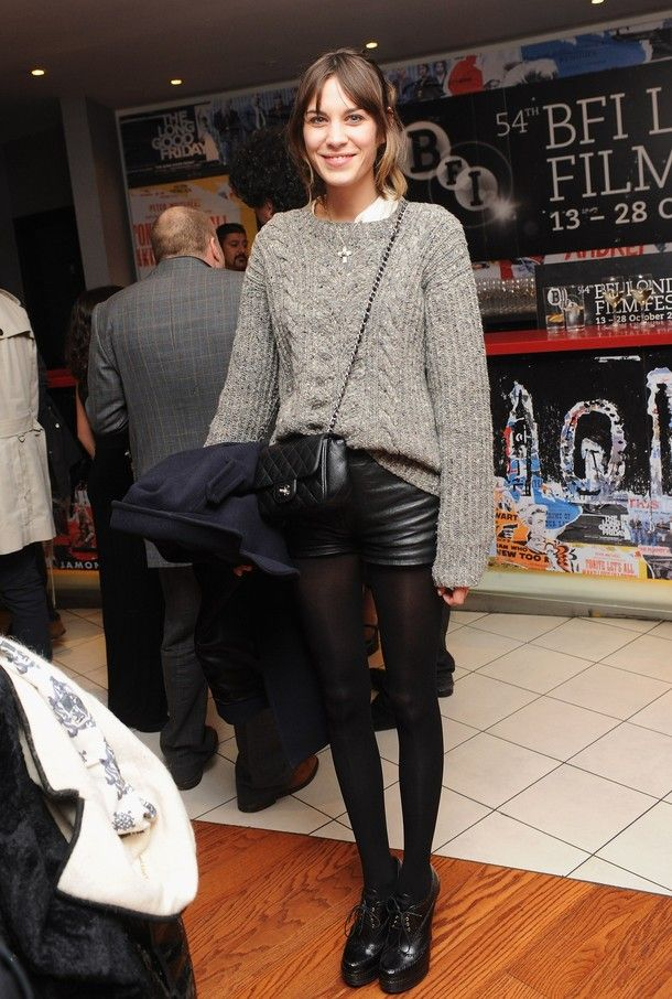 Alexa Chung (grey cable-knit, leather shorts, tights)