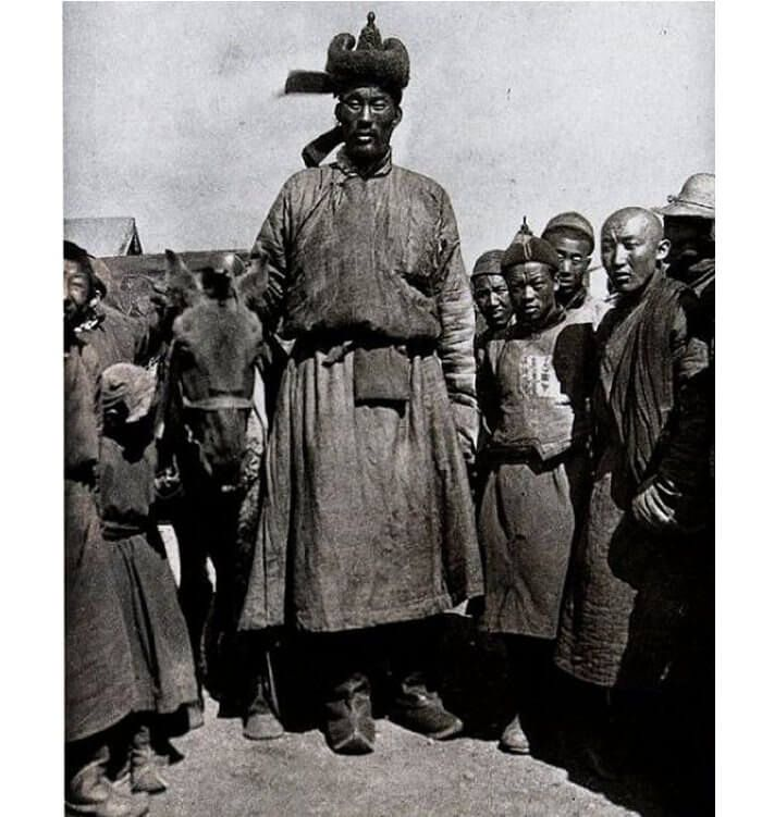 Giant photographed in Ulaan Baatar, Mongolia in 1922. Assuming even an average height of 5'4″ for his companions, this giant must have towered close to 8 feet tall — truly a giant among unusually small Mongolians. The man is considered one of the original giant descendants of Magog. Photo credits: Steve Quayle