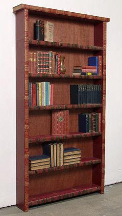 This book shelf and everything else on this site is made from recycled hardback books. Jim Rosenau is a remarkable artist!                                                                                                                                                     More