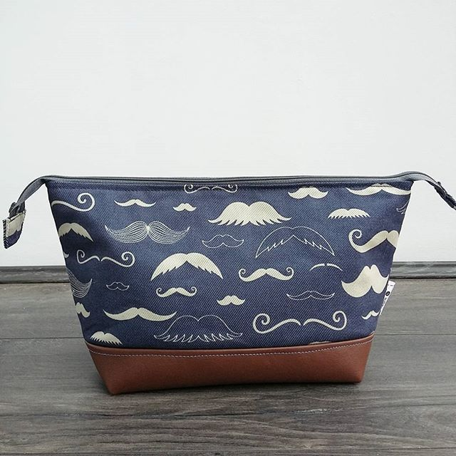 One for the menfolk!  A custom wash bag in this fab denim blue Japanese moustache print with faux leather base and water resistant grey lining.