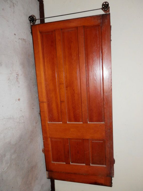 A huge antique solid wood door with rolling hardware for Barnwood pocket door