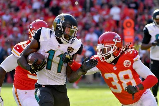 Jaguars vs. Chiefs  -  19-14, Chiefs  -  November 6, 2016  -  Nov 6, 2016; Kansas City, MO, USA; Jacksonville Jaguars wide receiver Marqise Lee (11) runs the ball as Kansas City Chiefs defensive back Terrance Mitchell (38) attempts the tackle during the first half at Arrowhead Stadium. Mandatory Credit: Denny Medley-USA TODAY Sports