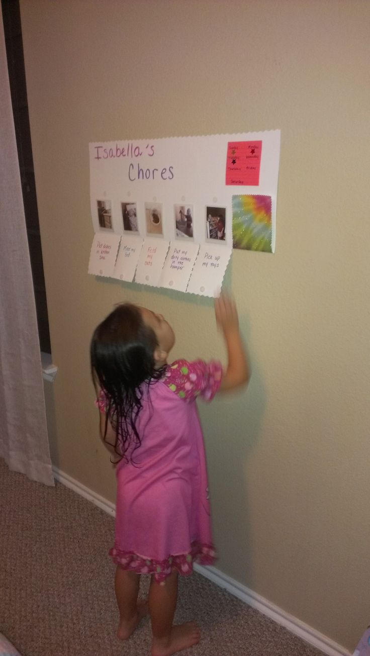 Preschool chore chart I made for my daughter. Made from a poster board, Velcro dots, self laminating photo pouches. Take pictures of your child doing the chore so they know what to do! The flaps fold up and Velcro closed to indicate the chore is done. Chore chart, toddler, preschool, pre-k, responsibility