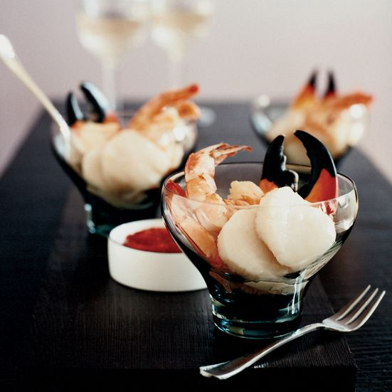 Here, Grace Parisi revamps the classic shrimp-cocktail recipe by including scallops and stone-crab claws, then tweaks the cocktail sauce by replacing ...