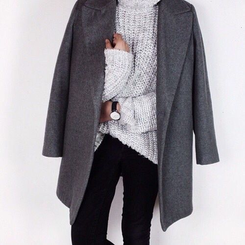 Light grey turtleneck sweater paired with a dark gray coat. We love this look.