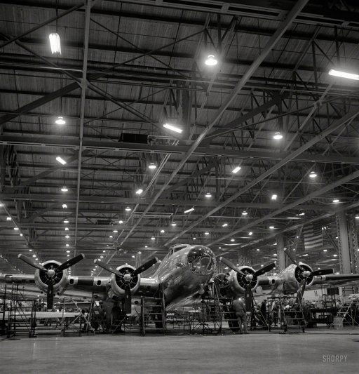 """December 1942, a year after Pearl Harbor. """"Production. B-17 heavy bomber. A nearly complete B-17F 'Flying Fortress' at Boeing's Seattle plant."""" Photo by Andreas Feininger for the Office of War Information."""