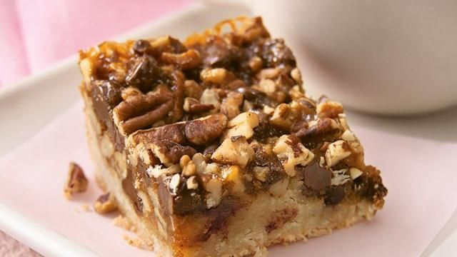Ooey-Gooey Turtle Bars: The classic pairing--chocolate and caramel--comes together once more in a simple, scrumptious bar.  |  Pillsbury.com