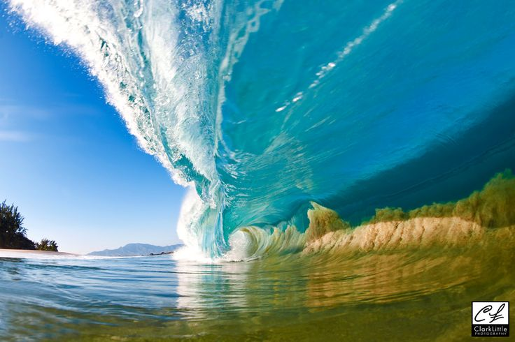 A large wave sucks sand from the sea floor into the wave itself - North Shore, Oahu, Hawaii- Clark Little