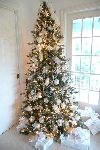 16 Amazing Christmas Tree Decorating Ideas- I love the idea of decorating the whole tree in white ornaments.