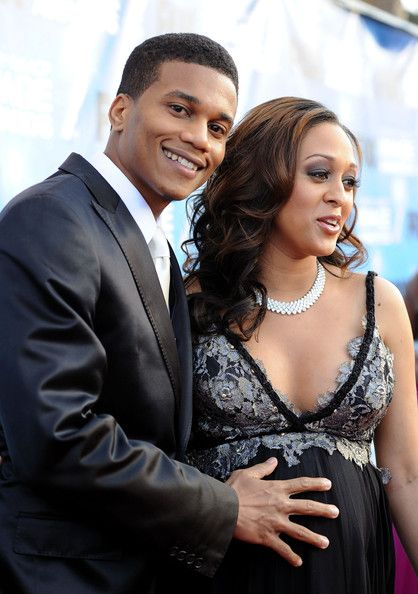 Actress Tia Mowry (R) and husband Cory Hardrict arrive at the 42nd NAACP Image Awards held at The Shrine Auditorium on March 4, 2011 in Los Angeles, California.
