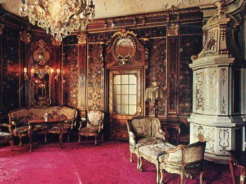 The furniture in the Music Room is carved of teak, a gift to King Carol I from the Maharajah of Kapurtala in India, while handmade silk embroideries adorn the ceiling and walls of the Turkish Salon. The ceiling paintings and decorative frescoes in the Theater Hall were designed by the renowned Austrian artists Gustav Klimt and Frantz Matsch.