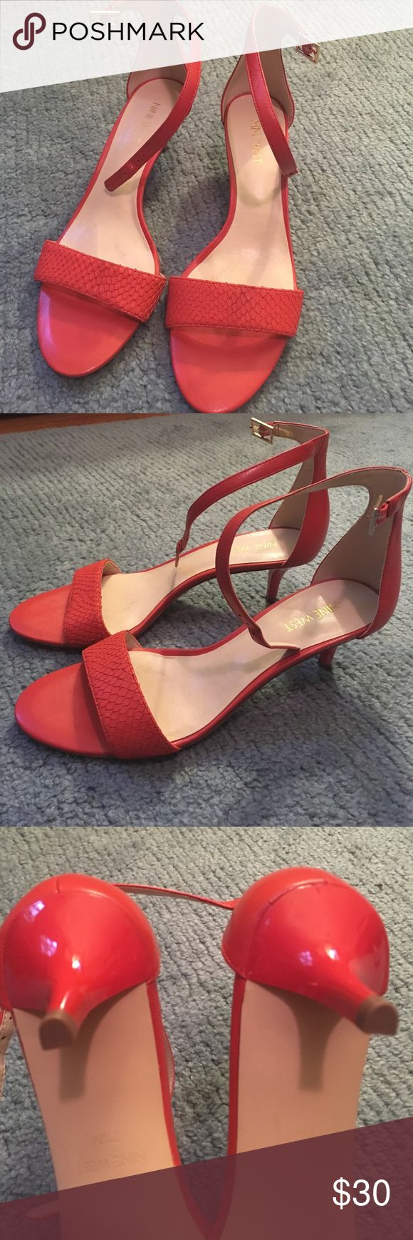 "Nine West coral orange kitten heels Nine West orange strappy sandal. Heel is 1 3/4"". Super cute and comfortable! Ankle strap is adjustable with gold buckle. Upper of sandal has a subtle snake skin pattern as shown in photos. EXCELLENT condition as these have never been worn! Great way to polish off your look with a pop of color, whether you pair these with a work dress or casual summer skirt Nine West Shoes Sandals"