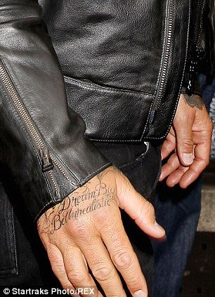 Latest inking: The 39-year-old star with Jay Z's lyrics 'Dream Big Be Unrealistic' tattooe...