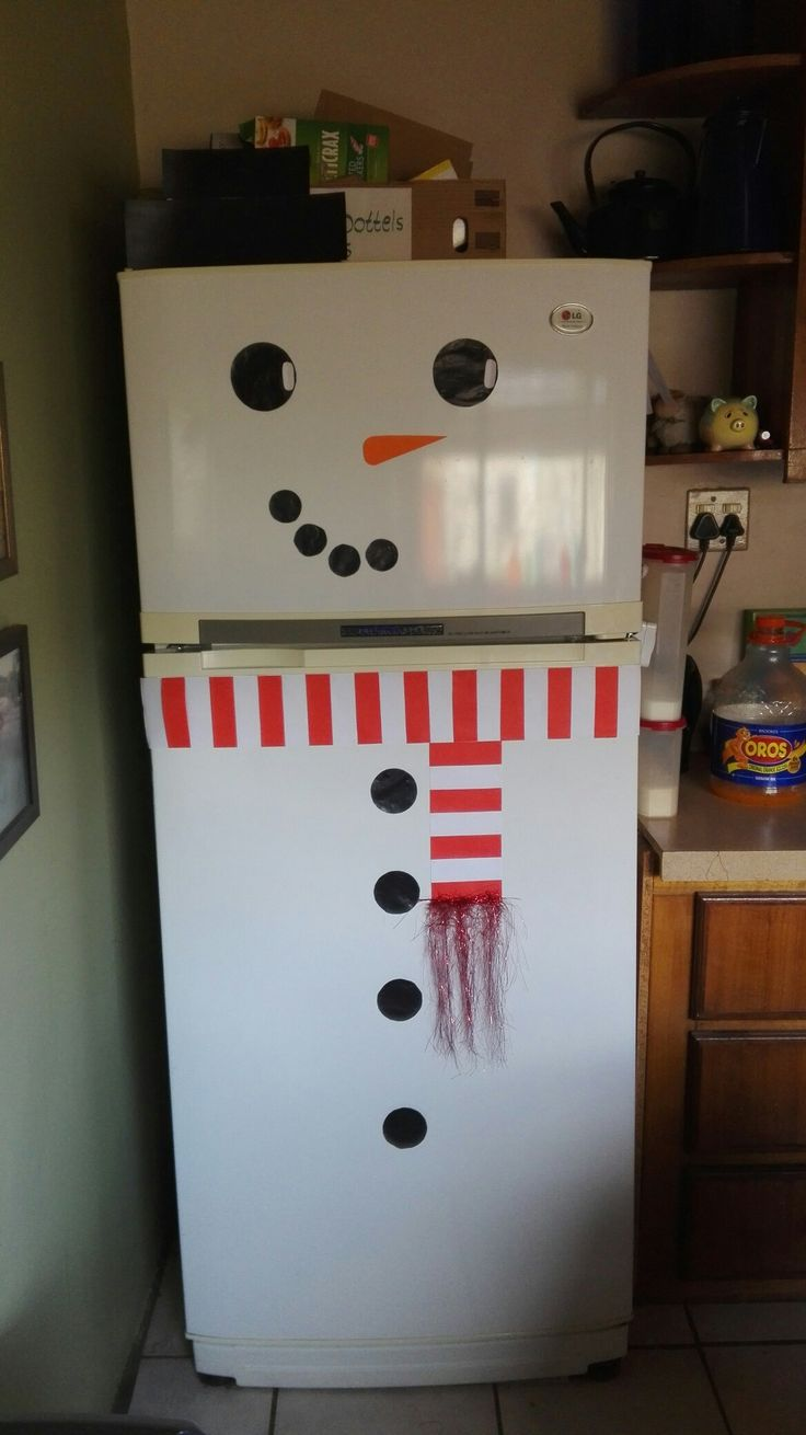 Cute snowman on fridge made out of paper (Hat is made out of carton) #Christmas #Snowman #Paper #ChristmasDecoration #FridgeDecoration #Red #White #Black