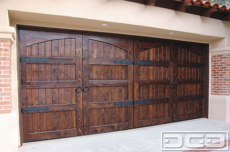 Breaking a large surface such as a double car garage door is simple. Designing a garage door that simulates smaller door panels as done on this Spanish Colonial custom garage door.