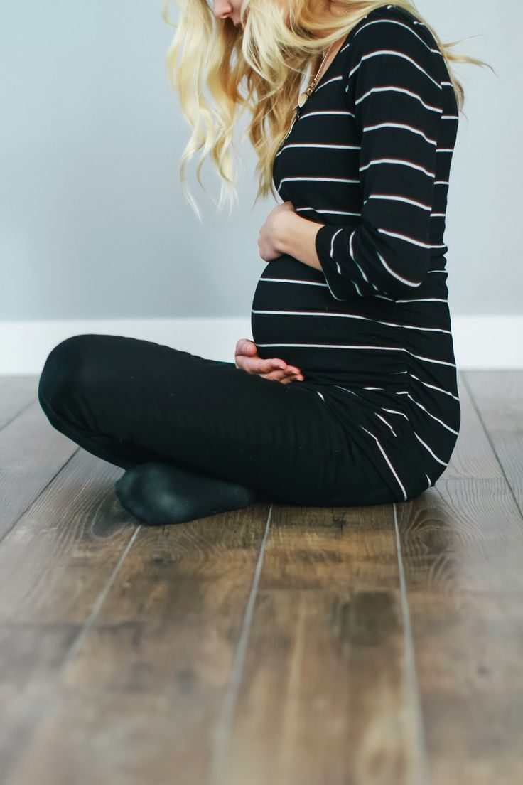 A comfy and casual maternity outfit for yoga, errands, or home - striped top and black leggings!