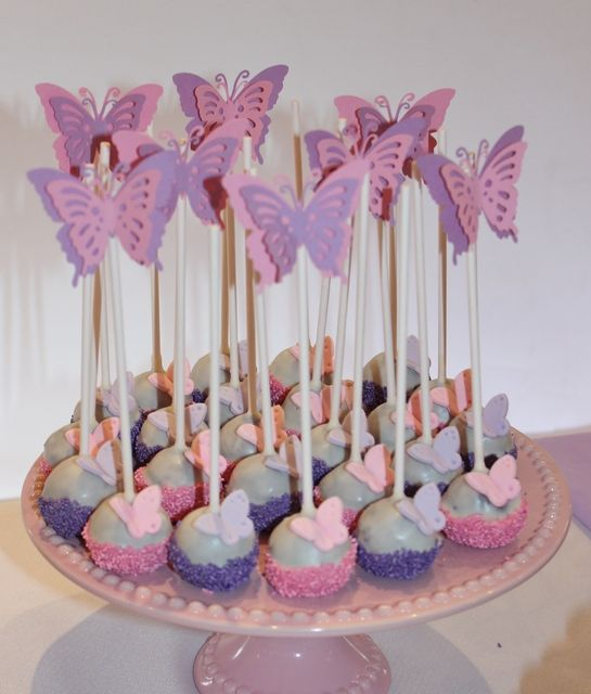 Butterfly topped cake pops from a butterfly birthday party! See more party ideas at CatchMyParty.com!