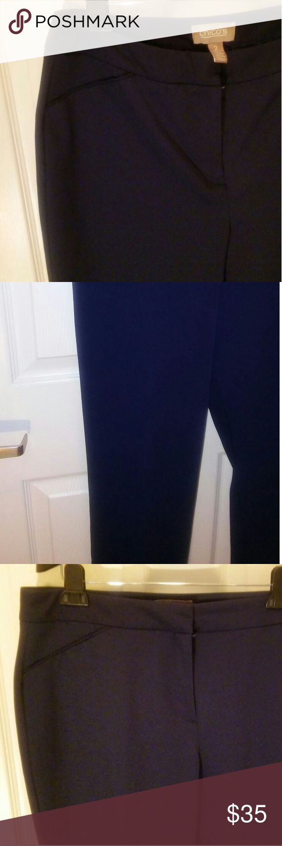 Chico's Navy Blue Dress PANTS SZ 12 (Chico's SZ 2) These are a very flattering nazy blue dress pant. They have an inner hook and eye and zipper closure, front diagonal slit pockets on each side and one horizontal slit pocket on the left rear. For additional photos or questions, please contact me. Chicos Pants