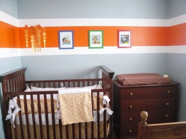 Love the stripes...not so much where they placed those frames :/ but could be a really cute room