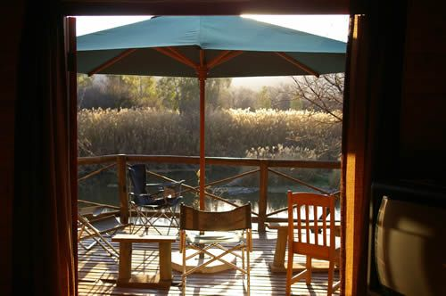 Fish Eagle Log Cabin in Potchefstroom. This double story thatched wooden log cabin is situated on the banks of the Vaal River in the North-West Province. The self catering accommodation comprises two private double rooms (one with en-suite) and two upstairs sleeping areas with two single beds each. Sleeps minimum 4 people and maximum 10 people.