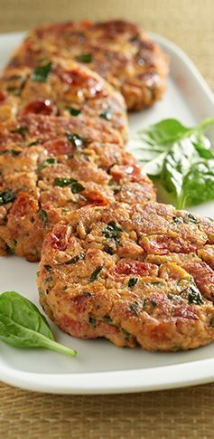 Flavorful salmon blended with seasoned tomatoes and spinach makes a colorful salmon cake.