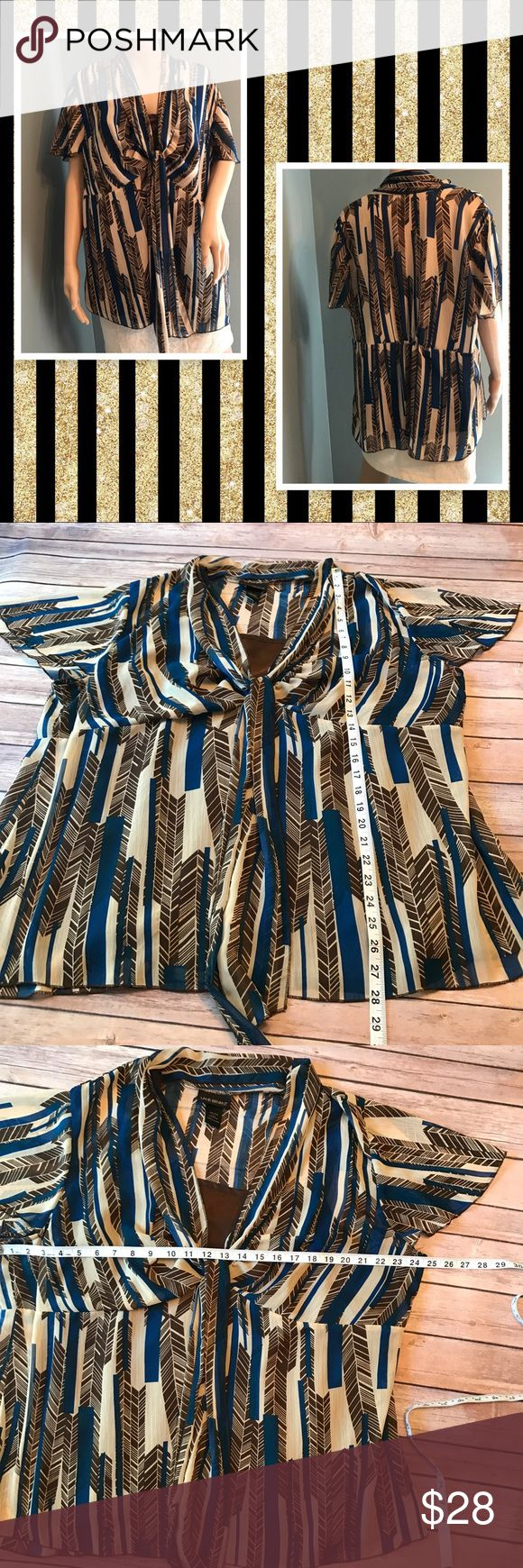 Lane Bryant 22/24 Sheer Top with tank underneath Beautiful blue, brown, and cream design. Top part is sheer with flutter sleeves. Underneath comes with a solid brown cami, Front neckline also has a tie. Size 22/24. 100% polyester Lane Bryant Tops Blouses