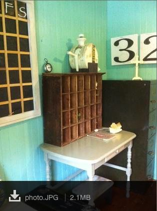 A great office space with an old steel filing cabinet, a wall calendar made from tin and cedar and a cute writing desk with an old set of postal boxes. What more do you need?