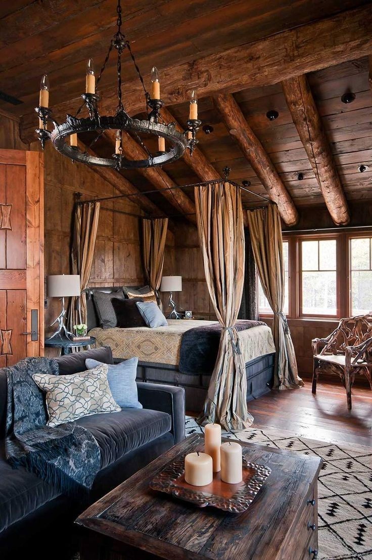 Four poster bed iron chandelier rich wood lends old world warmth to luxury montana cabin more source dancing hearts yellowstone traditions
