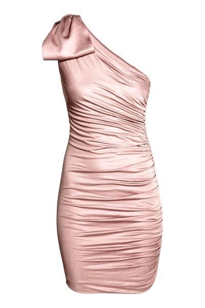Vestido de un hombro: Vestido ajustado en punto de viscosa con ligero brillo. Modelo de capa doble con un hombro al descubierto, un lateral fruncido y lazo decorativo en un hombro.