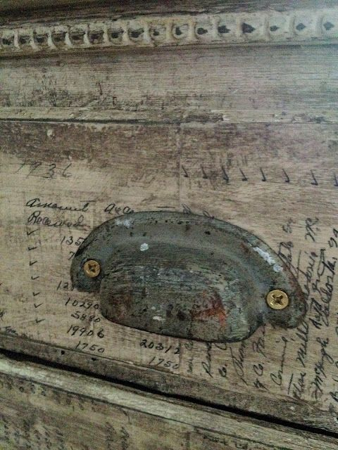 decoupaged ephemera on dresser drawers