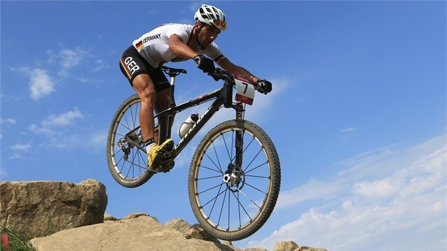 Manuel Fumic of Germany competes in the men's Cross-country Mountain Bike race