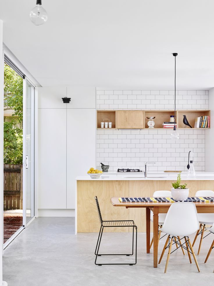 I love white spaces! If you are looking to warm it up a bit, timber is the perfect solution!