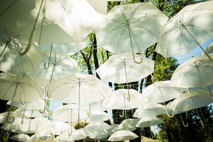 I love the umbrellas as a sun shield!  Could we do something like this at Benedict Castle??  Would they let us string anything up, or would we have to bring a structure to hook it all into?