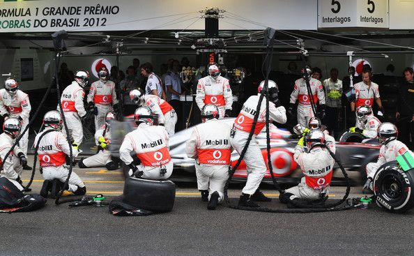 Jenson Button of Great Britain and McLaren drives in for a pitstop on his way to winning the Brazilian Formula One Grand Prix
