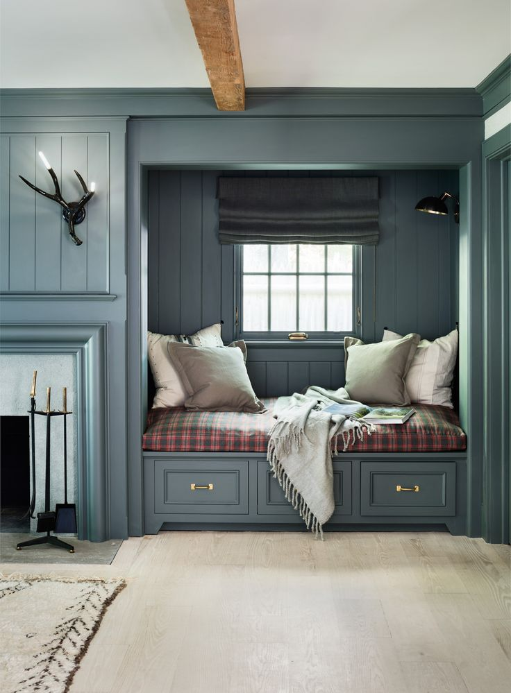 reading-nook-painted-gray-blue-with-built-in-cushions-and-antler-light