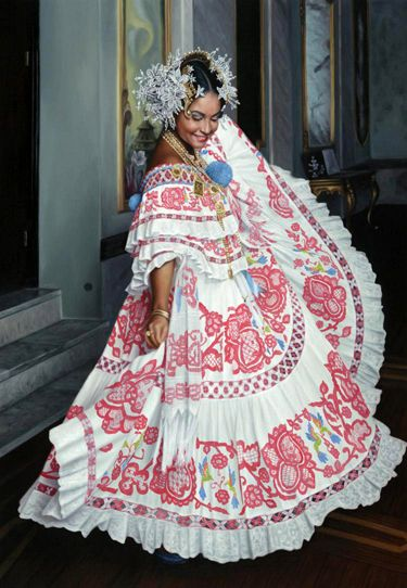 South America | Portrait of a woman wearing a beautiful pollera, the national dress of Panama