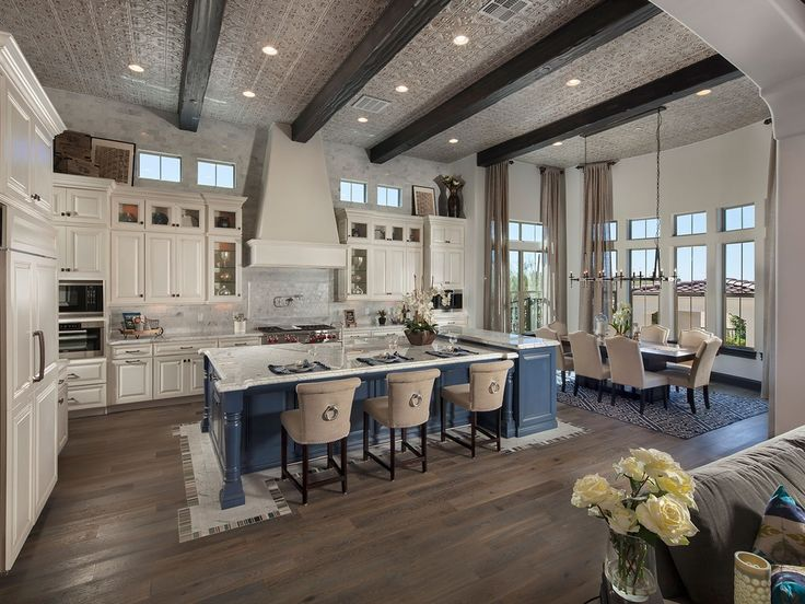 Unique kitchen idea: combine wooden beams with a tin ceiling for an unexpected, luxurious look.