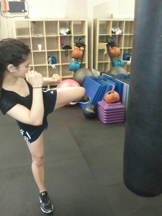 Lorelei working out with Muay Thai kick drills... Get it!
