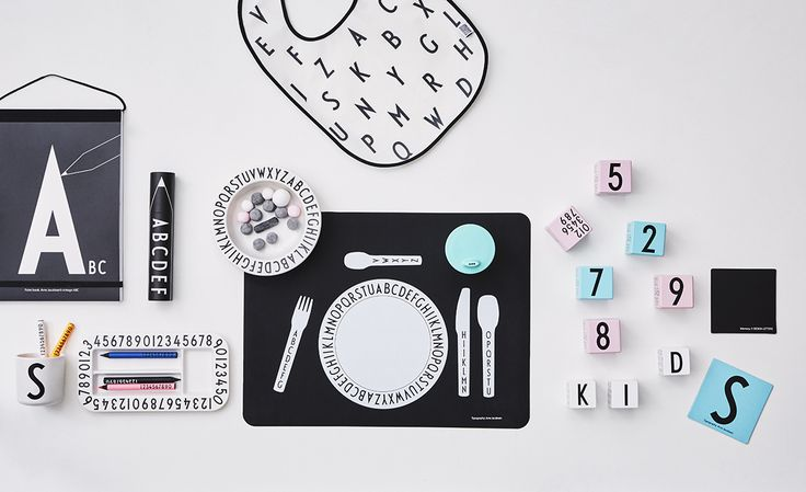 Eat, Play and Learn. A selection of our Kids range. Including melamine tableware, placemat, bib, colour book, crayons, memory game and wooden cubes with numbers and letters. Typography: AJ Vintage ABC.
