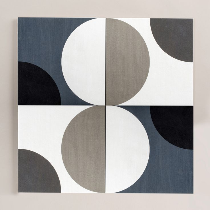 These cement and encaustic tiles juxtapose dynamic patterns with muted colors to…