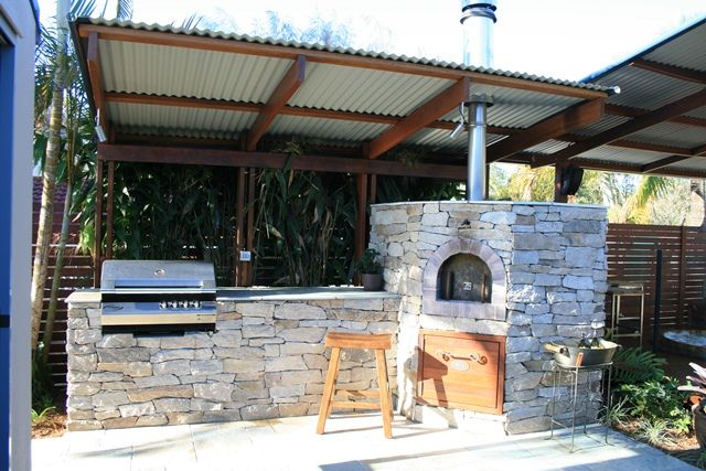 Outdoor Kitchen with Pizza oven and Stainless steel BBQ