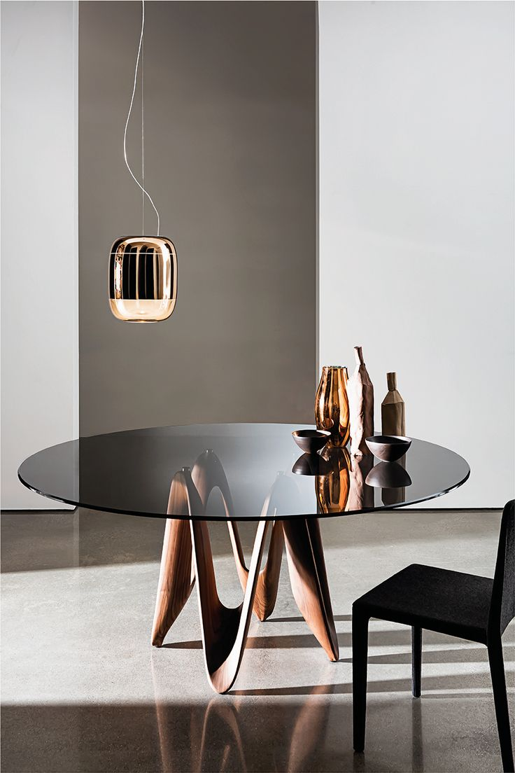 The beautiful Lambda shapes enriched by the smoked glass top #Sovetitalia #design #interirors