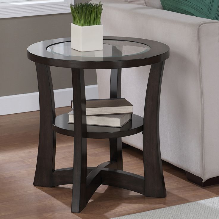 The modern Eclipse end table features a rich espresso finish, making it an ideal choice for any contemporary decor. This end table also offers a clear glass top and a lower shelf design that completes the look of this elegant piece.